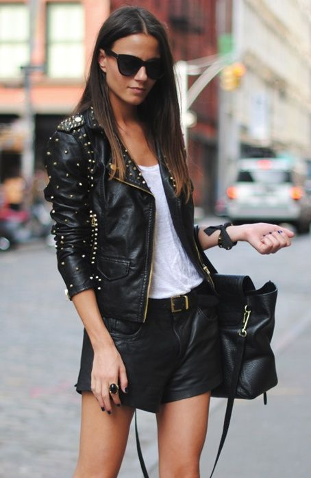 Young woman in a leather jacket