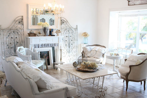 Shubby Chic living room with a mirror in antique white frame