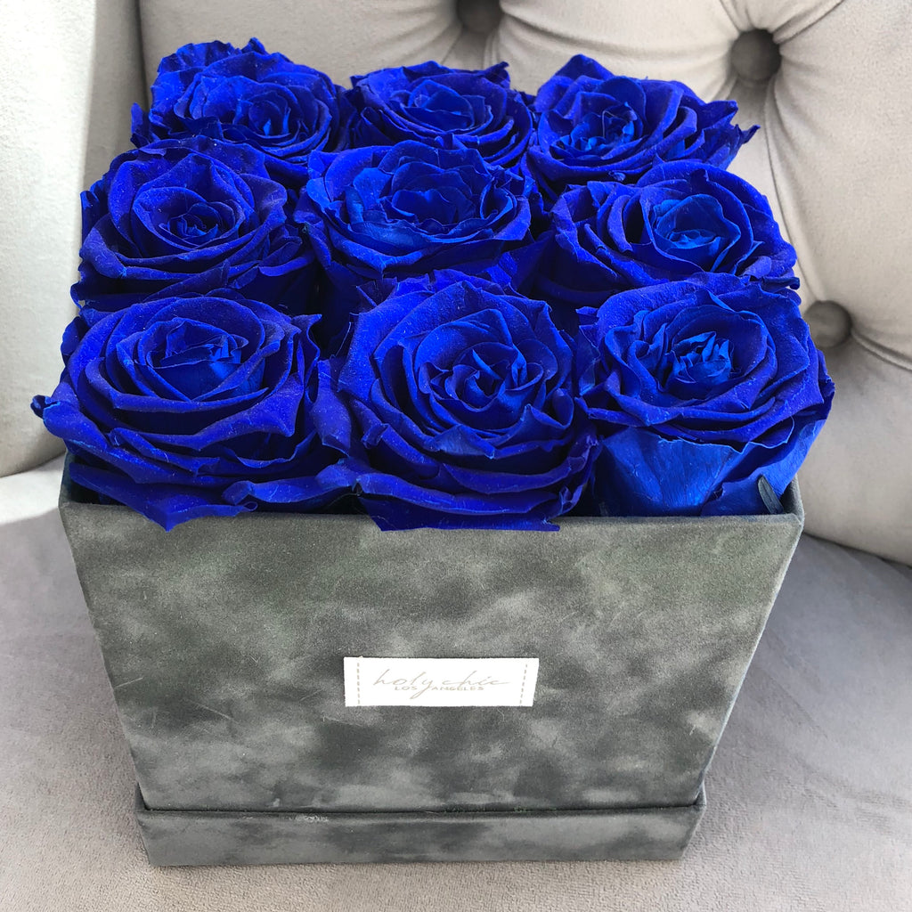 Preserved roses in a square velvet hat box