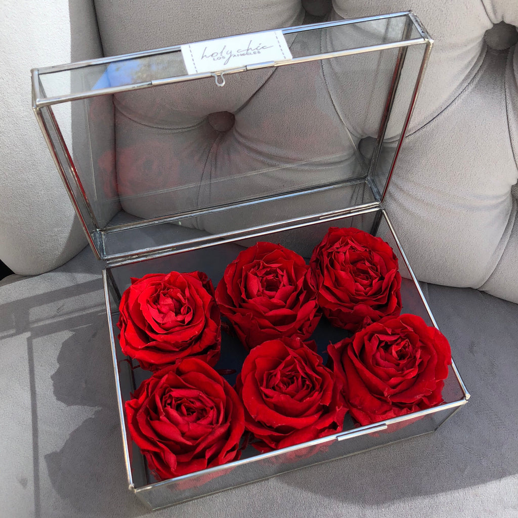 Preserved roses in a rectangular glass box