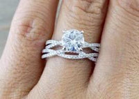 14k White Gold Solitaire Round Brillant Moissanite Diamond Engagement Promise Ring Charles & Colvard One Twist Infinity Love 7mm Set