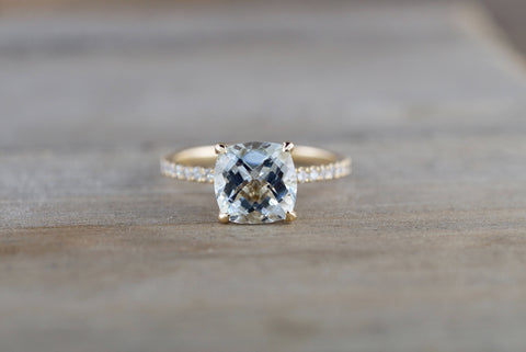 14k Yellow Gold Cushion Checkerboard Aquamarine set in a diamond mounting 8x8mm