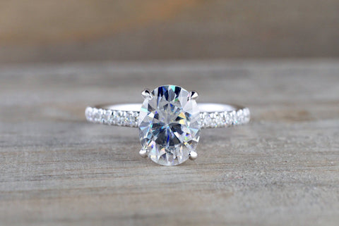 18kt White Gold Oval Charles and Colvard Forever One Moissanite set in diamond under halo mounting 9x7mm Engagement Ring