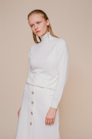 Softly Structured Ribbed Turtleneck Sweater