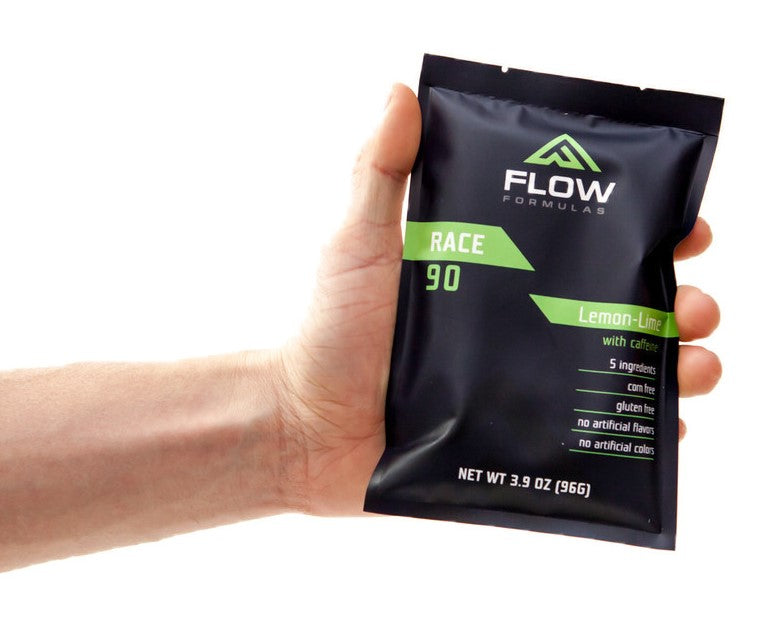 Hand holding packet of Flow Formulas