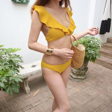 Fashionable hot sell lovely fresh pure color split hot spring lotus leaf edge swimsuit sexy two-piece suit bikini