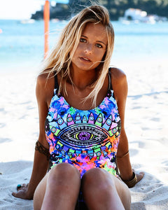The fashion trend is a hot, one-piece printed swimsuit with a sexy back bikini