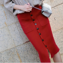 Women's autumn and winter new temperament Slim wild stretch of a row of buckle fashion skirt