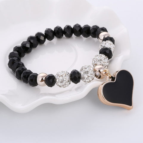 Beautiful assorted reflecting beads with shambhala beads with a centerpiece of an acrylic heart charm. Instead of classic chain, a more fun concept of stretch bracelets is brought back. What's good about that is it can fit anyone. Girl Code
