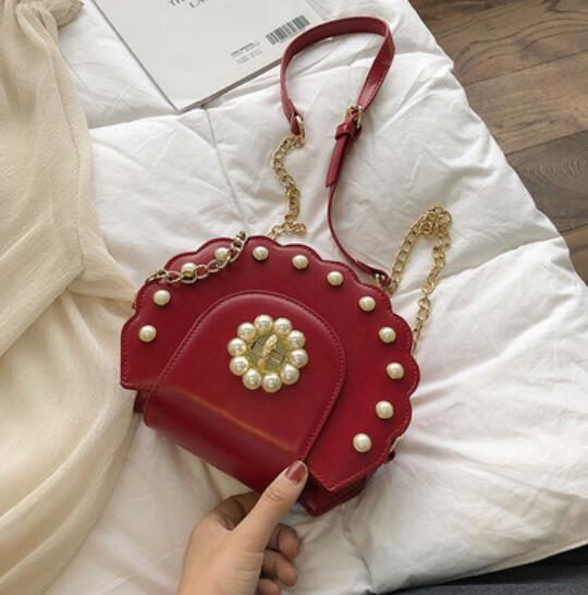 2020 Summer New Saddle bag High Quality PU Leather Flip bag Women's Designer Handbag Pearl Lock Chain Shoulder Messenger Bags