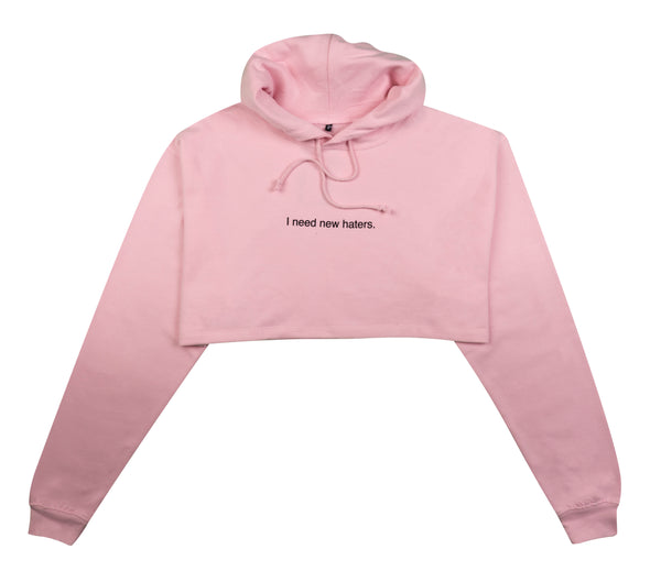 I NEED NEW HATERS LIGHT PINK CROPPED HOODIE