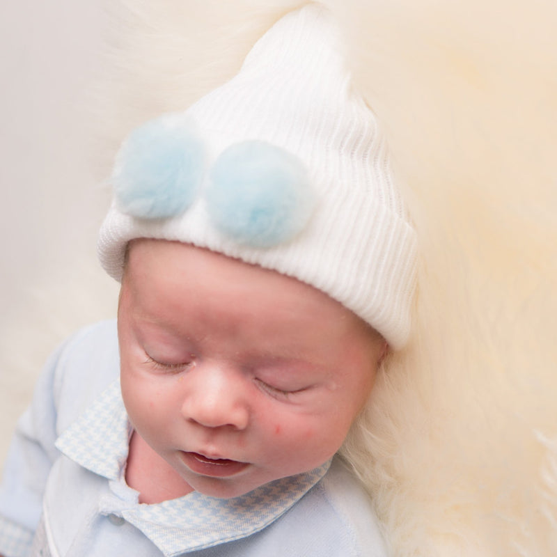 First Size White Hat With Blue Fur Pom Pom