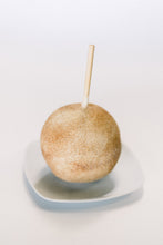 White Chocolate Dipped Caramel Apple with Cinnamon Sugar