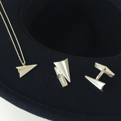 Silver paper plane necklace and cufflinks