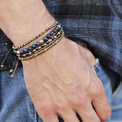 beaded bracelets on a man's arm