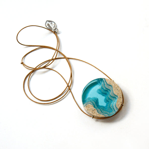 The Abyss Necklace is made from beach sand and colored resin. Beach jewelry