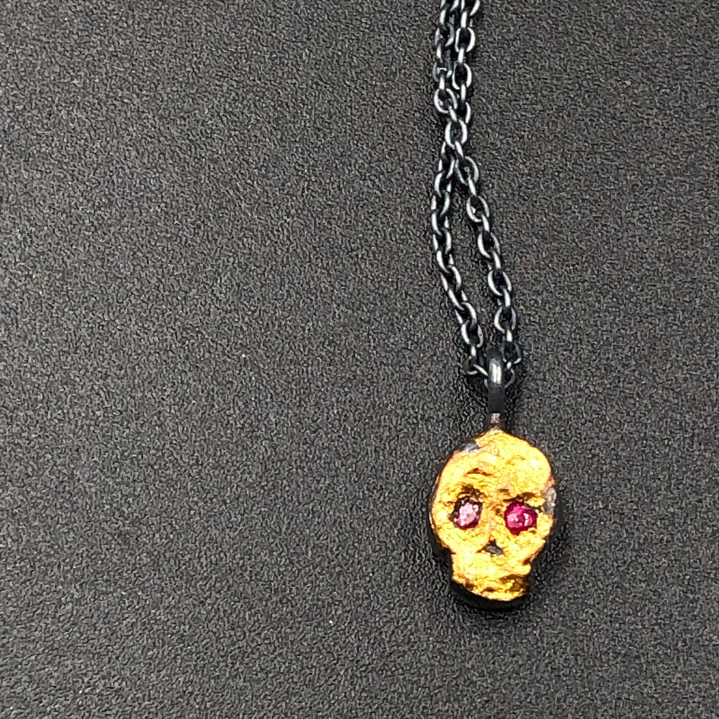 Tiny Skull Pendant with Ruby