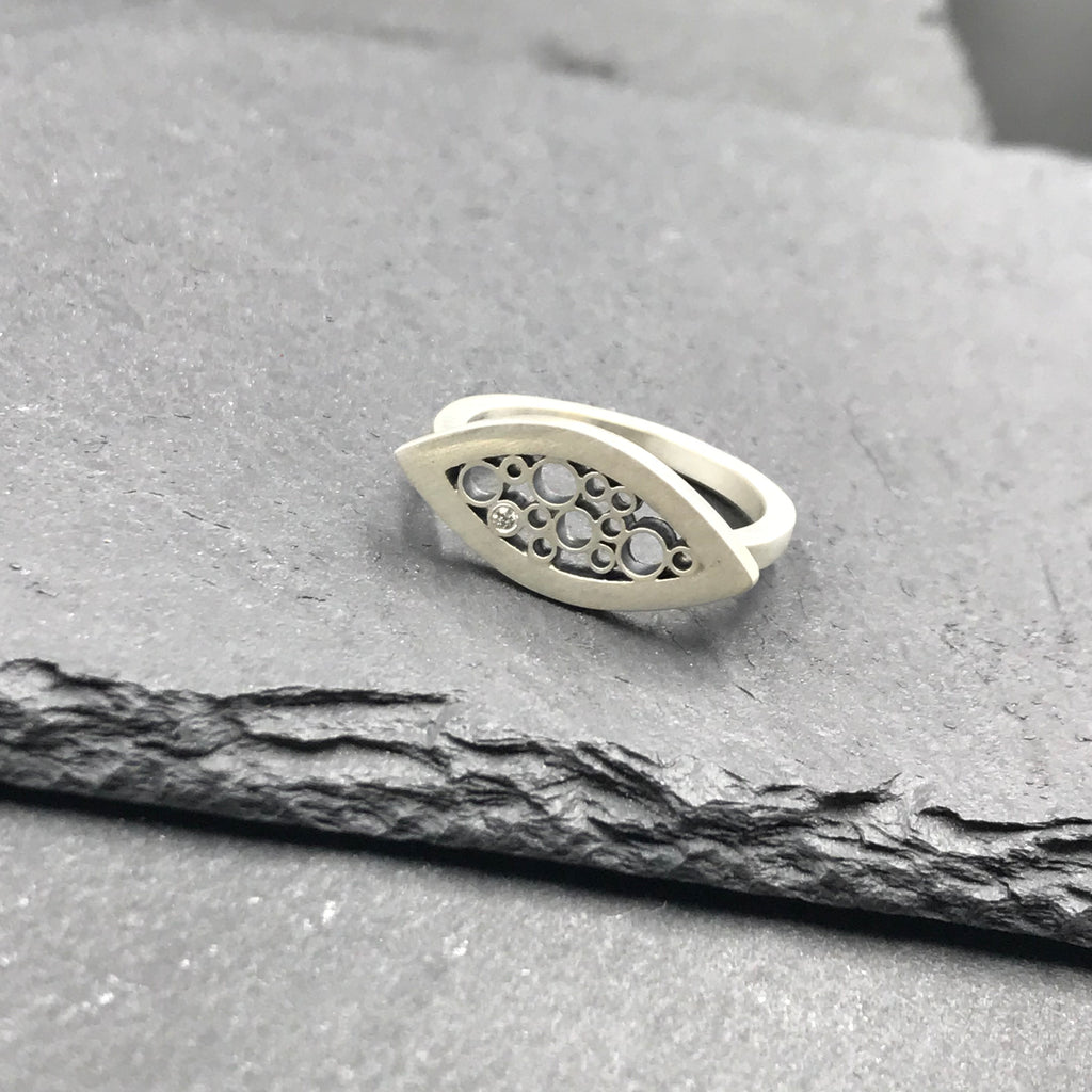 Petite modern abstract botanical everyday ring made from sterling silver and recycled diamond. Birthstone and anniversary jewelry