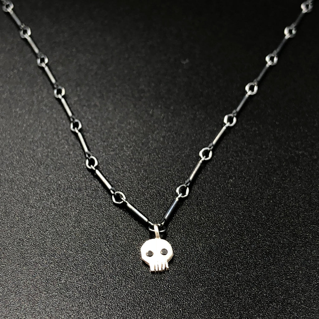 Single Skull Necklace in Silver with Black Diamonds