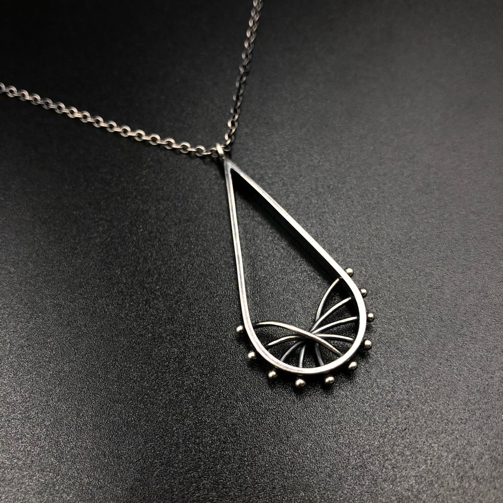 Droplet arc necklace