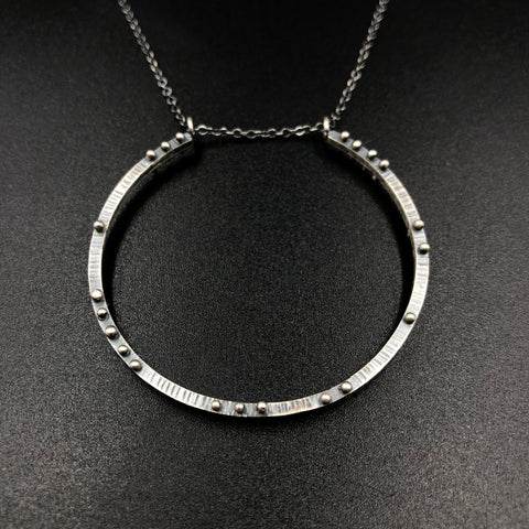 Incomplete circle necklace with scattered dots