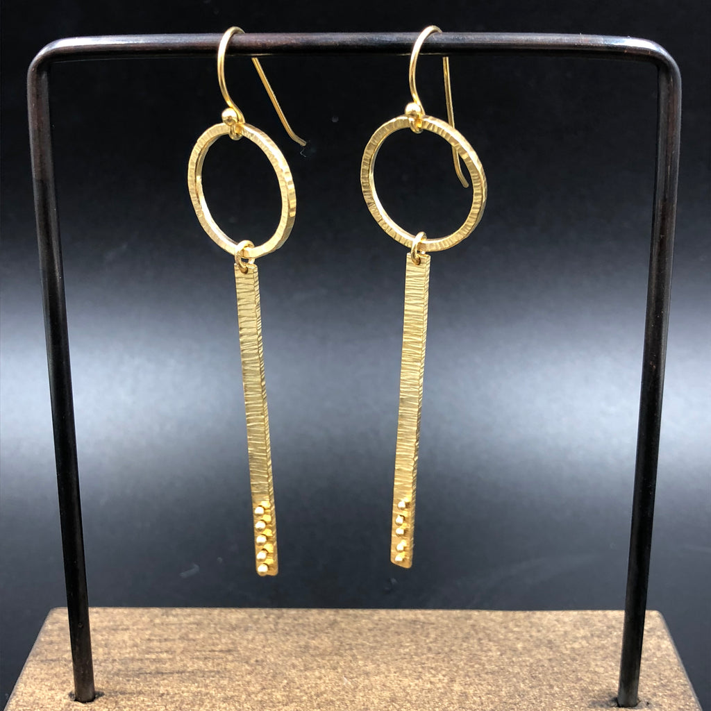 Gold circle and branch earrings