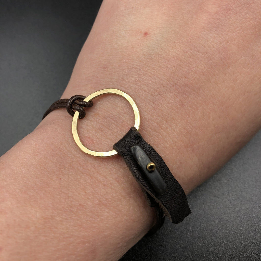 Gold Ring and Leather Bracelet