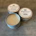 Natural soy-coconut candles in metal tins.
