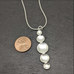 Five Parabolic Discs Necklace