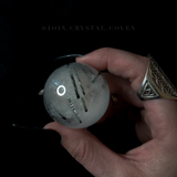 The Reflections of Duality Tourmaline in Quartz Crystal Ball