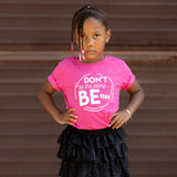 DON'T BE THE SAME BE BETTER. Kids PINK graphic tee