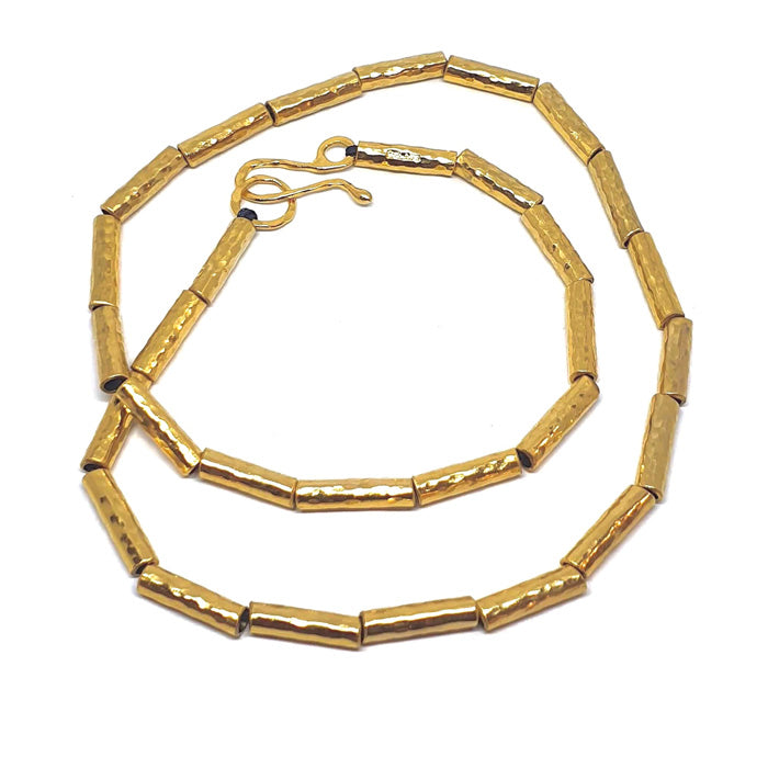 Kauri bead necklace in gold