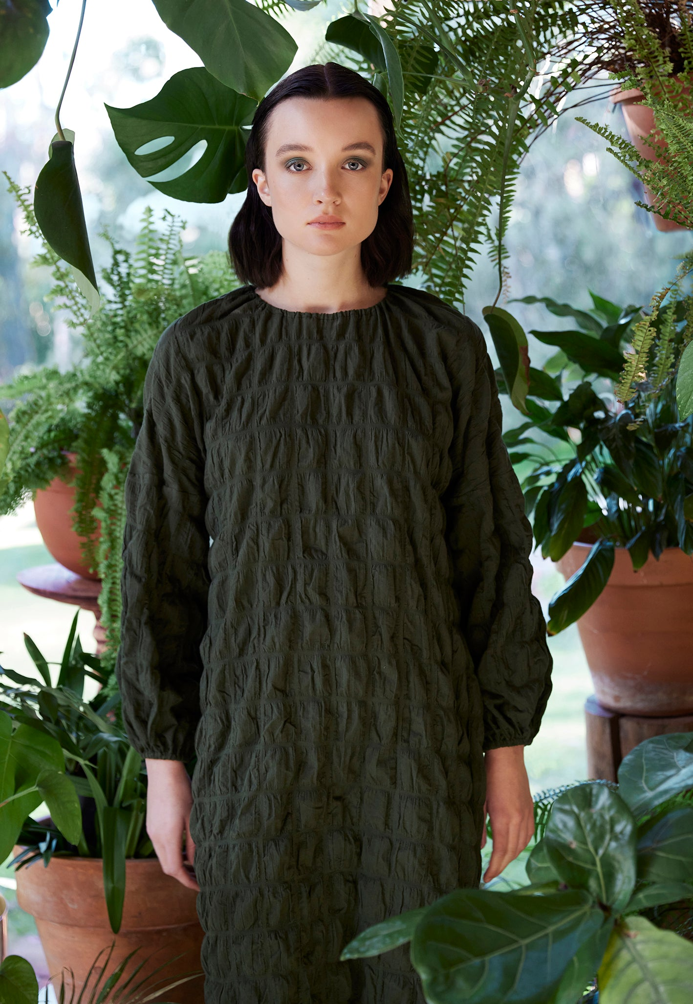 green textured long sleeved gathered dress plant fashion photography campaign keegan the label
