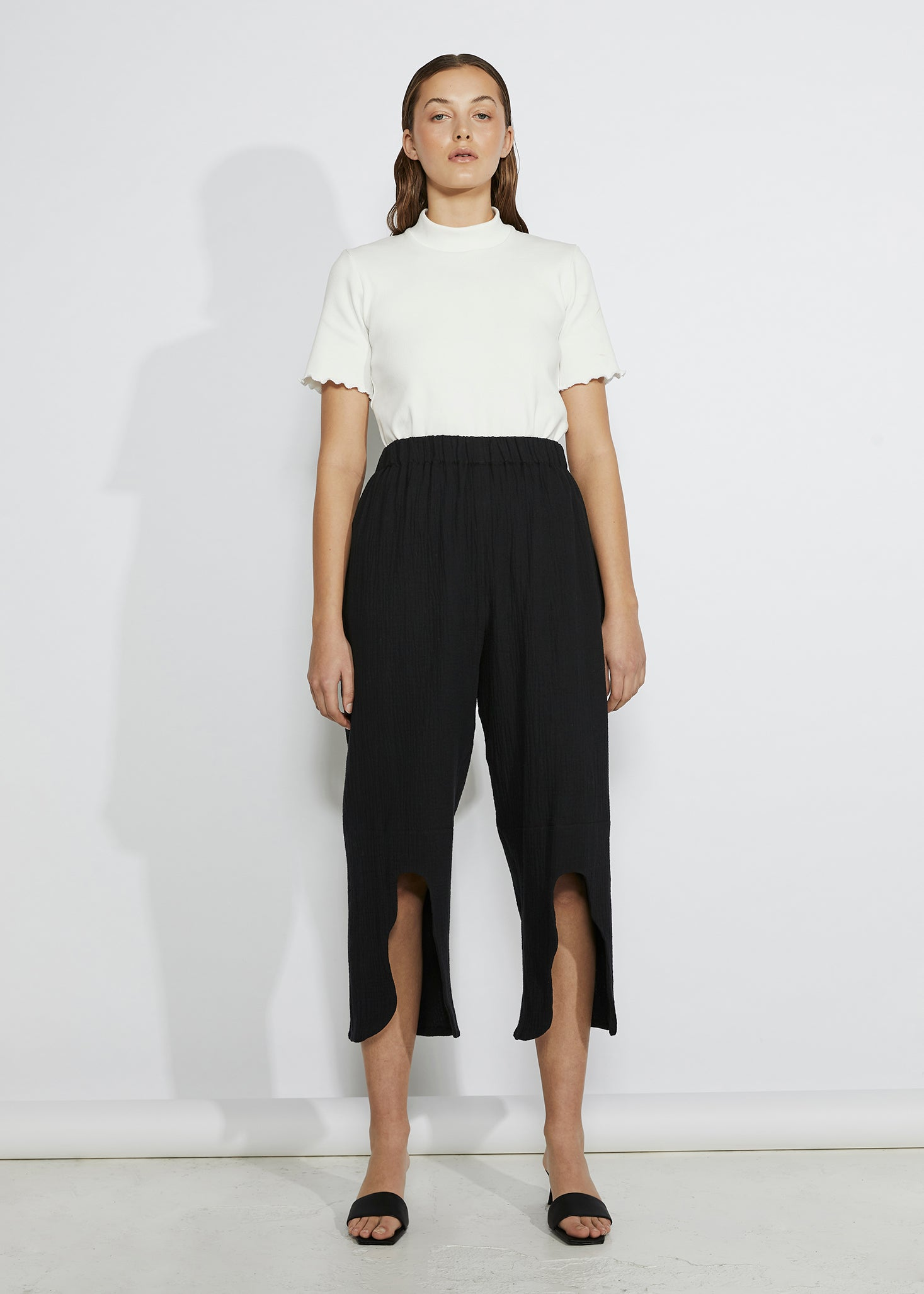 keegan heavy metal look book. Slow handmade fashion. White Tshirt frills, black cut out pants