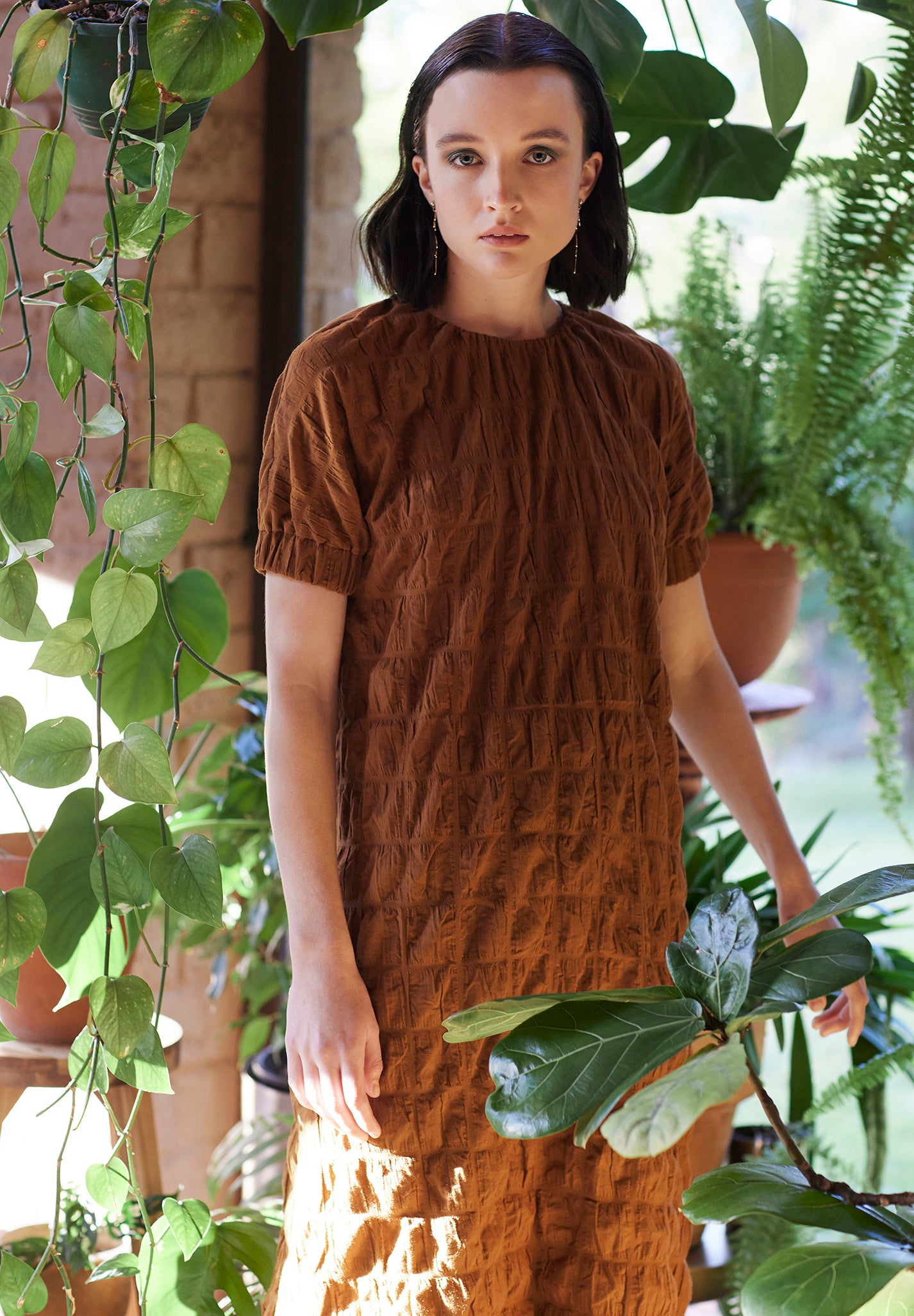 orange brown gathered short sleeved dress plant conservatory campaign keegan the label