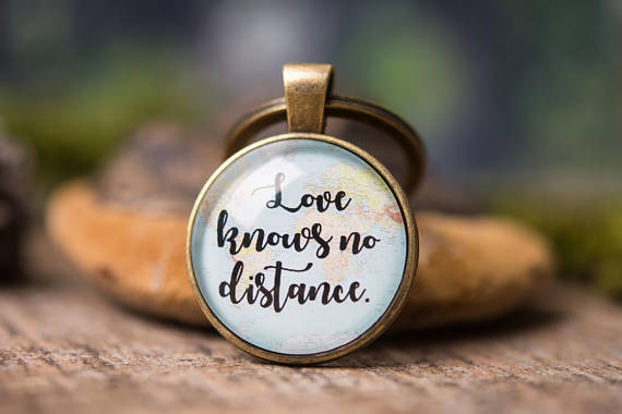 """Love knows no distance"" map keychain."