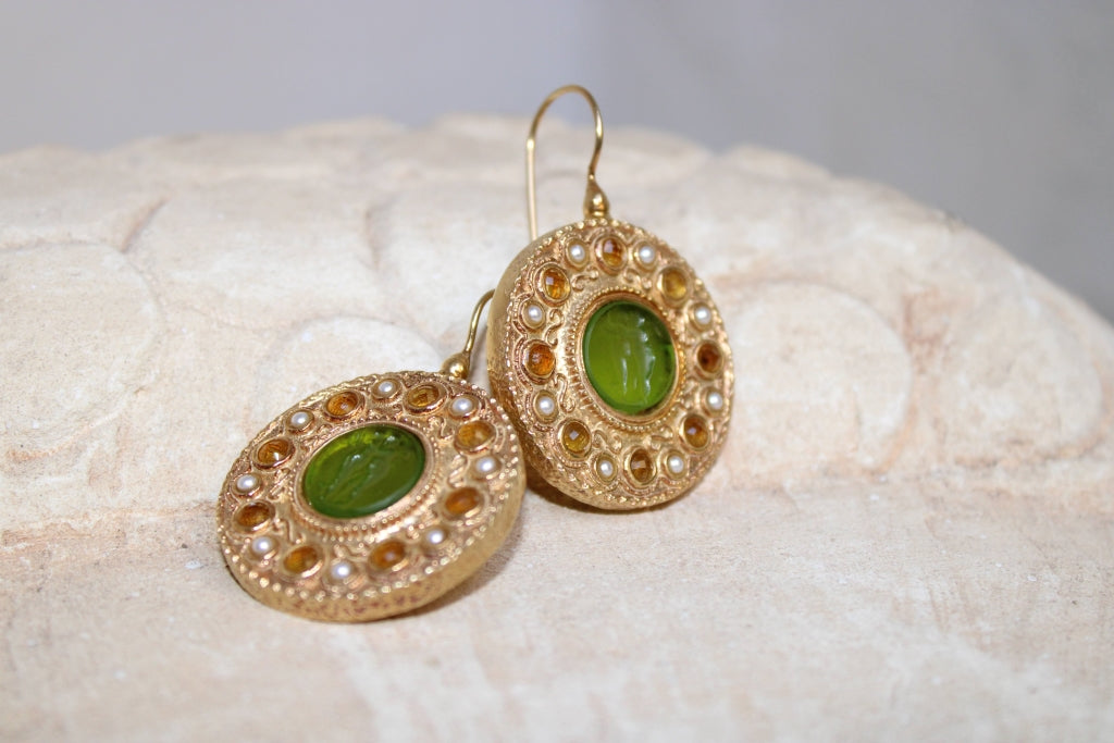 Two Winged Figures Glass Paste Earrings in Green