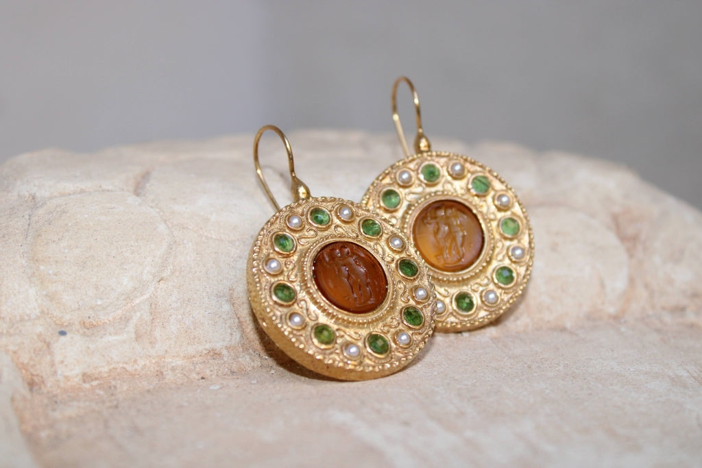 Two Winged Figures Glass Paste Earrings in Amber