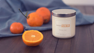 Grapefruit, tangerine, and ginger scented pure soy wax candle