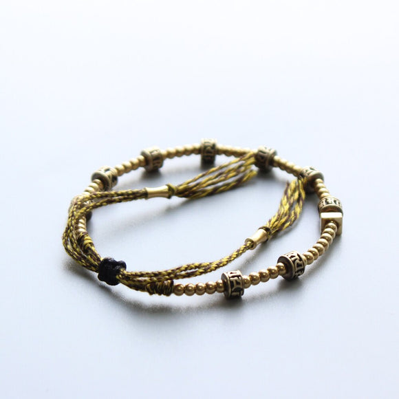 Golden Om Mani Padme Hum Bracelet with Hand Braided Cotton Thread