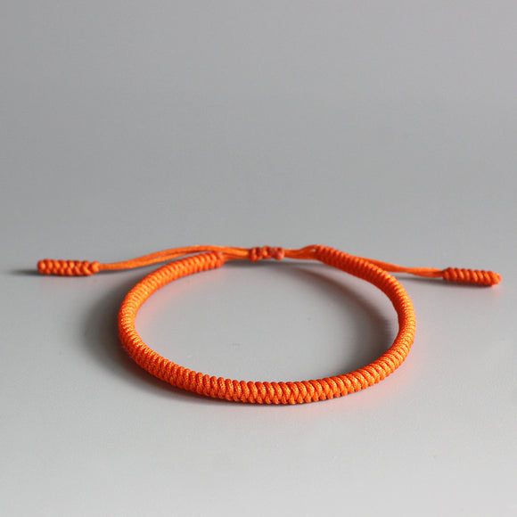 Handmade by Monks - Orange Knot Bracelet
