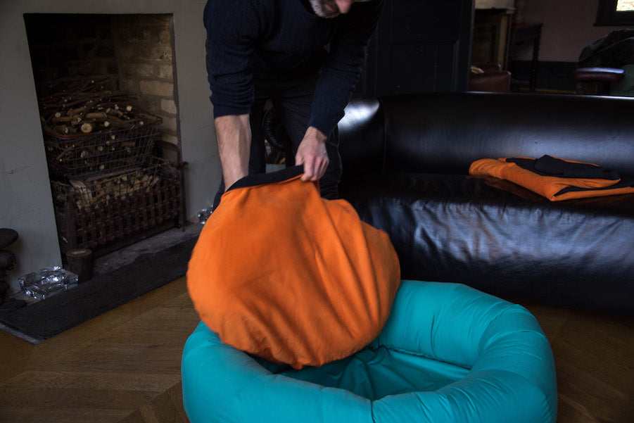 dog bed with orange cover