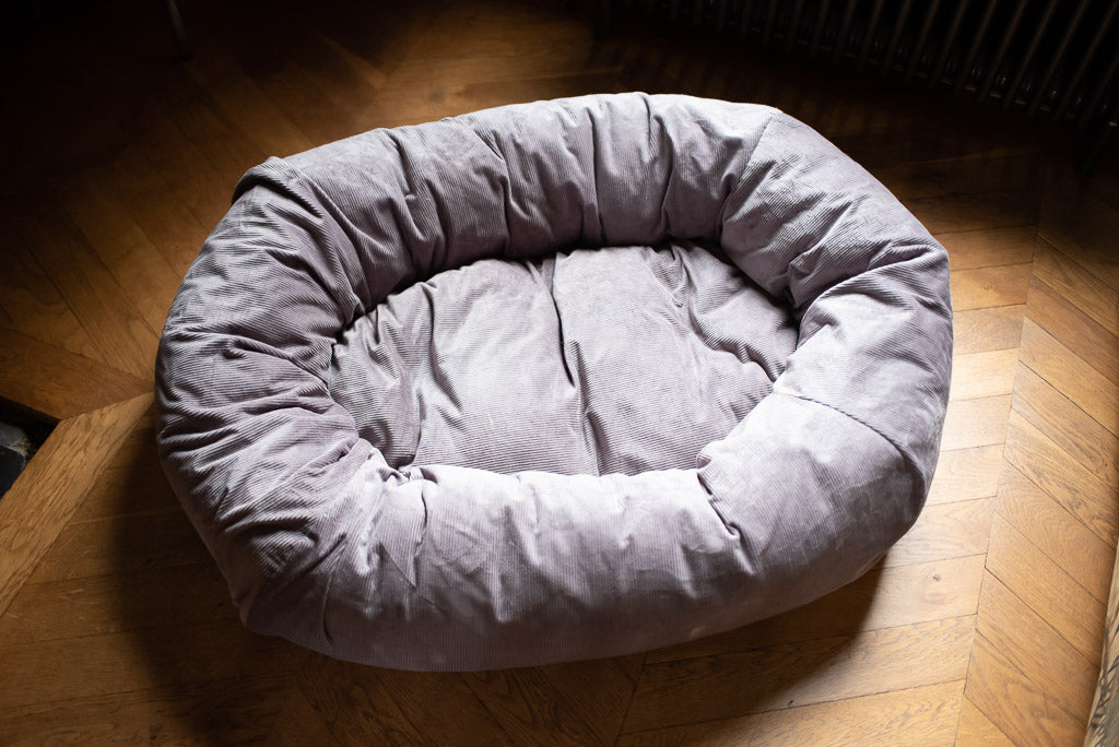 grey corduroy dog bed with bolster