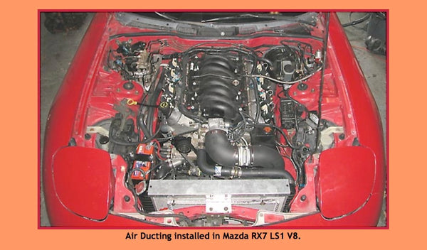 Stealth Conversions air ducting and clamps installed in a Mazda RX7 with LS1 V8.