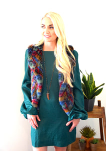 Blonde woman wearing C&B Furs multi-color rex rabbit fur vest