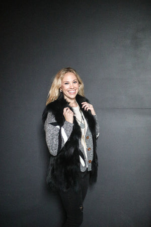Blonde woman smiling wearing C&B Furs Full Fox Fur Black Zip Vest