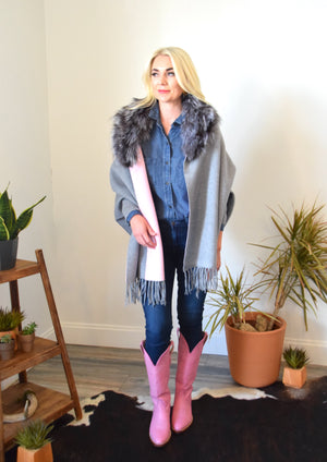 Woman wearing two tone shawl with Full silver collar, pink cowboy boots