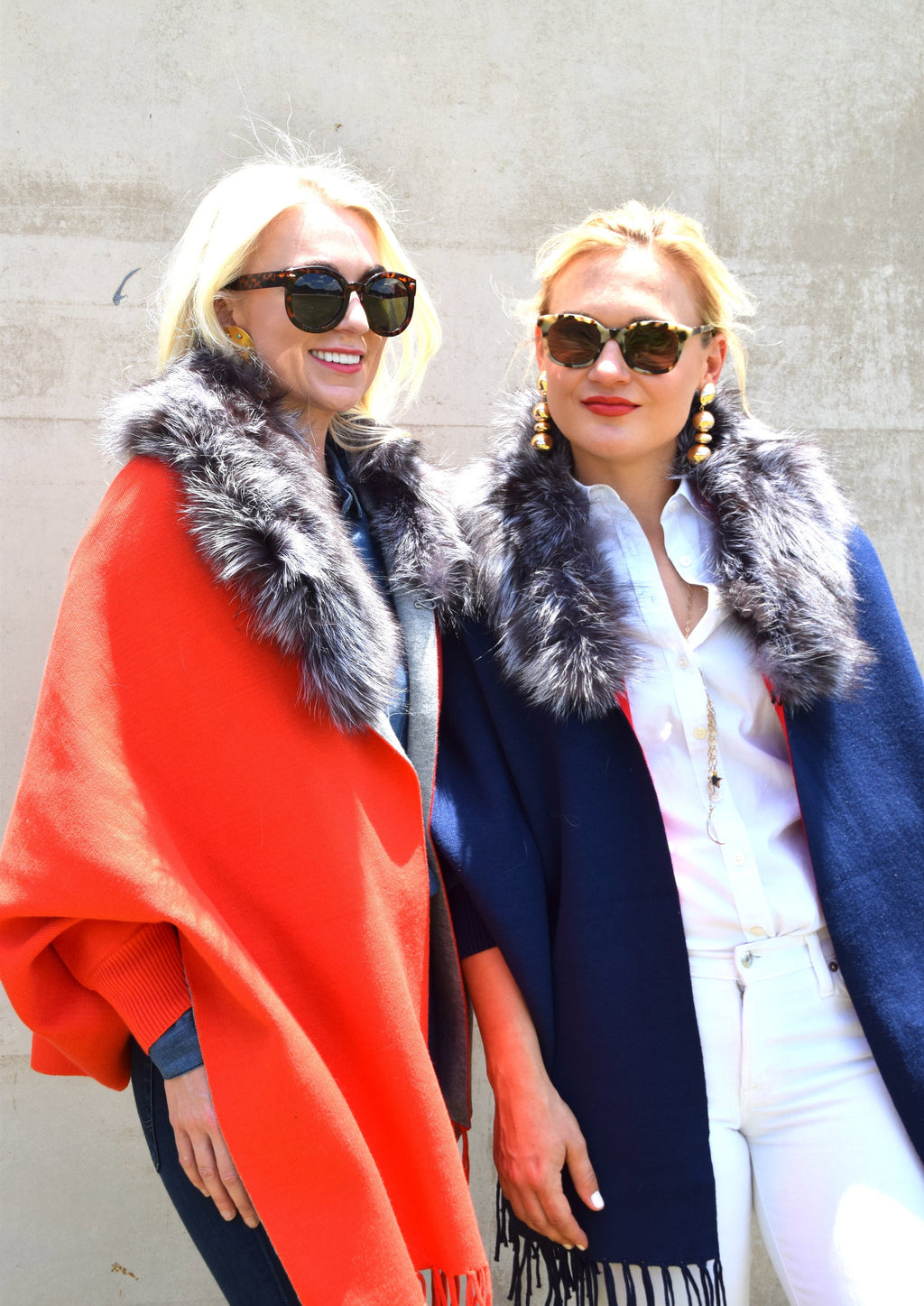 2 Women wearing C&B Furs red and blue Two-Toned Shawls