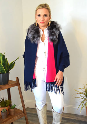 Woman wearing C&B Furs Blue Two-tone shawl with full silver collar, White denim pants