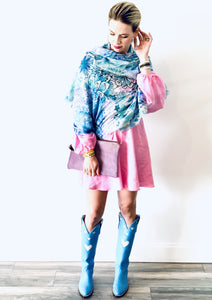 woman wearing pink dress, blue boots, C&B Furs blue cashmere silk scarf